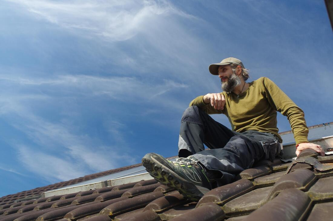 man sitting on the roof